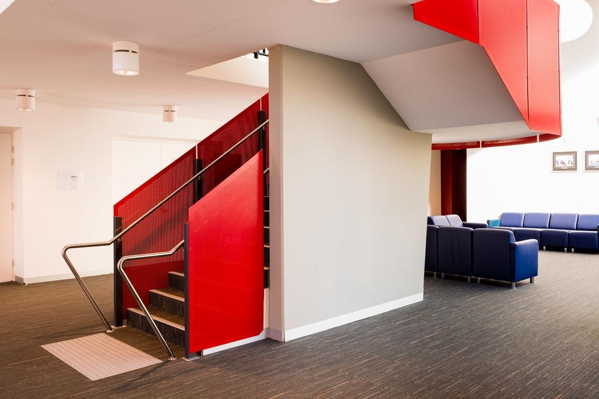 Balustrade design tips - coloured balustrade at a sports centre