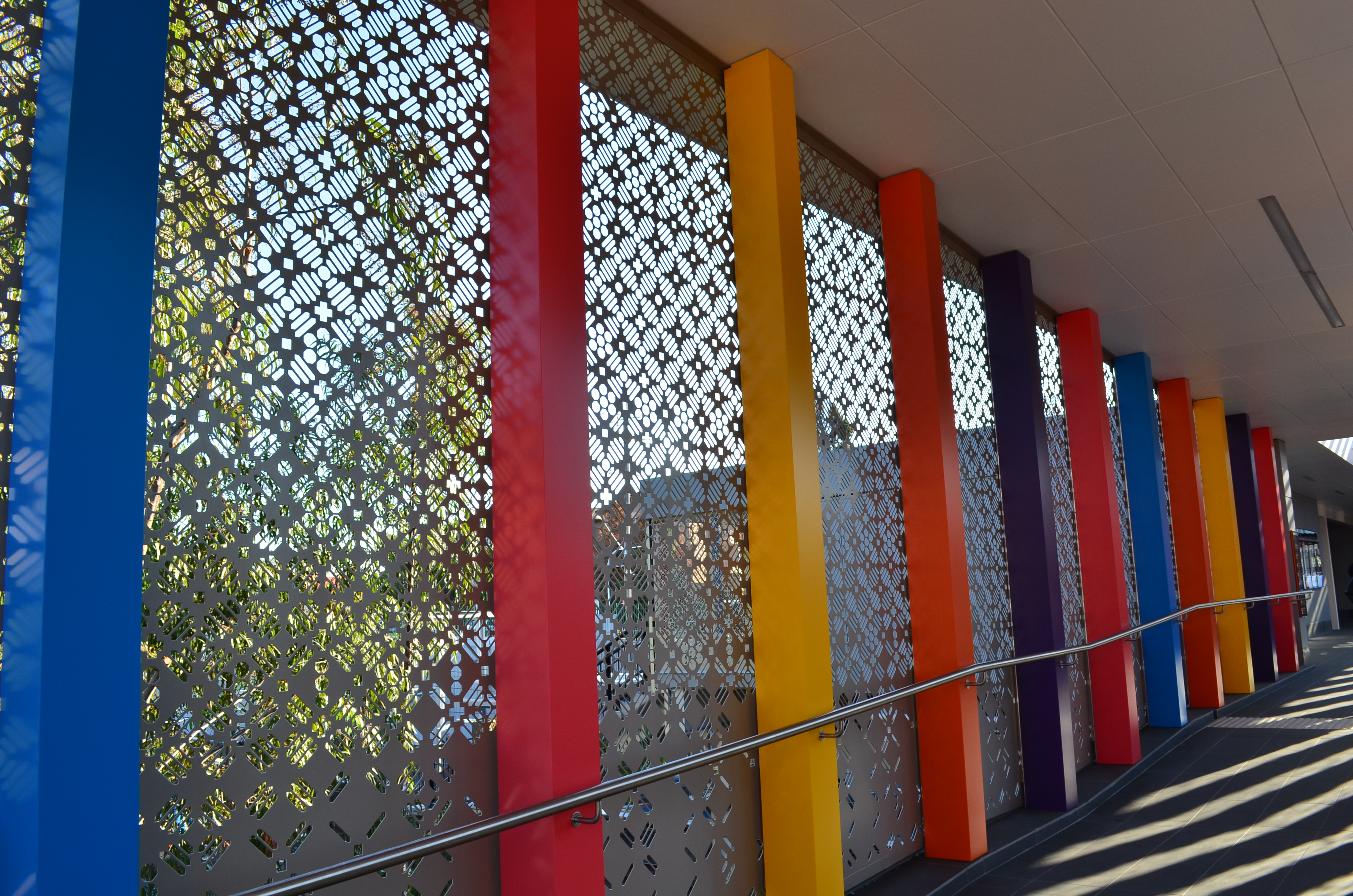 Bespoke perforated metal design -Harris Park Station
