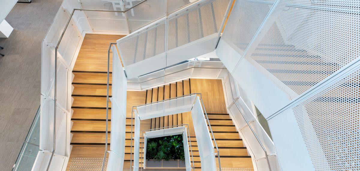Bespoke perforated metal design by Arrow Metal - Staircase at 100 Mount St., Sydney